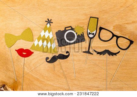 Colorful Party Decoration For Photograph Such As Party Hat, Bow Tie, Red Lips, Glass, Flute And Came