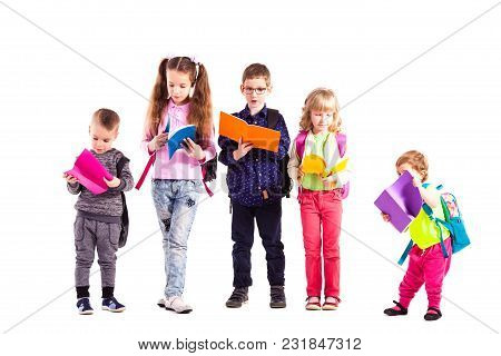 Senior Pupils Help The Younger Ones Isolated On The White Background. Schoolboy And Schoolgirl Share