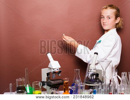 Very Smart Schoolgirl With Chalk Standing Near Blackboard In The Laboratory Classes In Chemistry And