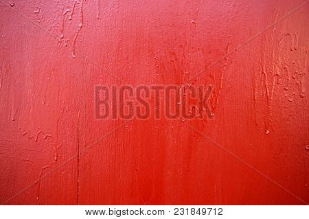 Texture Of A Surface Painted With Red Paint. The Corners Of The Texture Are Darkened