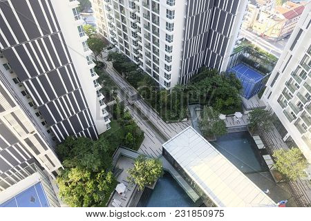 Aerial View,swimming Pool In Residential Suburb Area House Surrounded By Green Garden And Foldable S