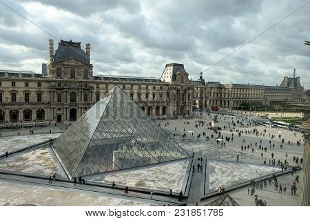 Paris, France - November 2017: The Glass  Pyramid In Louvre Paris, France. It Serves As The Main Ent