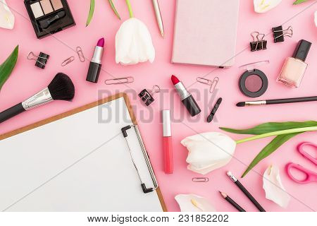 Beauty Composition With Clipboard, Tulips Flowers, Cosmetics And Accessory On Pink Background. Top V
