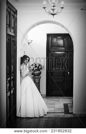 Monochrome Portrait Of The Bride At The Wall. Vertical Frame
