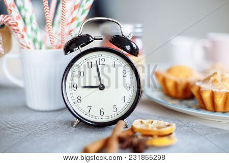 Alarm Clock And Breakfast On A Gray Table