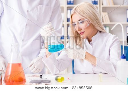 Young woman chemist working in clinic lab