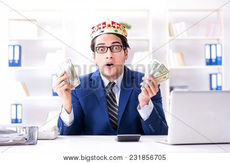Businessman king with money in the office