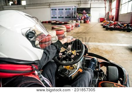Close Up Of A Karting Driver In Helmet Indoors