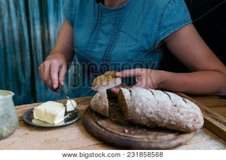 Close Up Female Hands Making Sandwich Putting Butter On Rye Bread