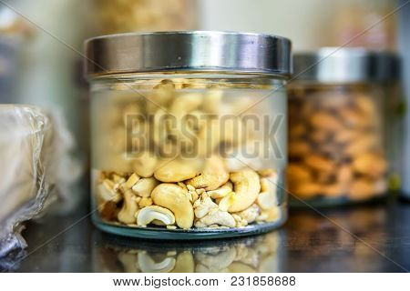 Close Up Jars With Different Nuts. Healthy Food Concept