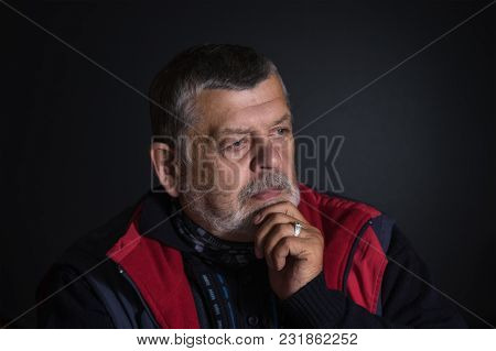 Nice Low Key Portrait Of Senior Man Thinking About Life Problems