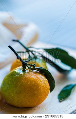 Studio Shot Of Two Fresh Juicy Tangerines With White Cloth In Background Winter Food Concept