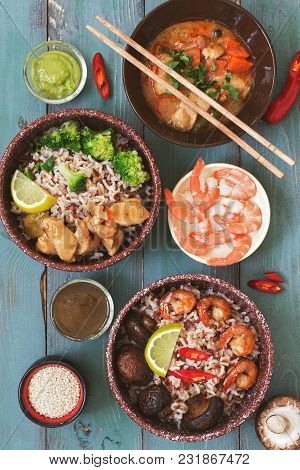 A Variety Of Dishes With Asian Food, Brown Rice, Fried Shrimp, Fried Mushrooms, Braised Chicken, Sau