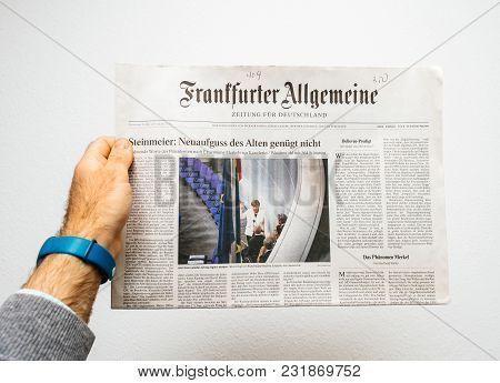 Paris, France - Mar 15, 2017: Man Reading German Frankfurter Allgemeine Zeitung Newspaper At Press K