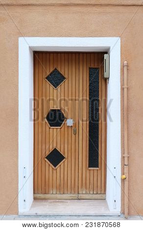 Vintage Closed Wooden Door With Glass Details And Silver Knob