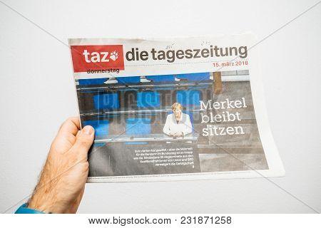Paris, France - Mar 19, 2017: Man Reading German Die Tageszeitung Newspaper At Press Kiosk Featuring