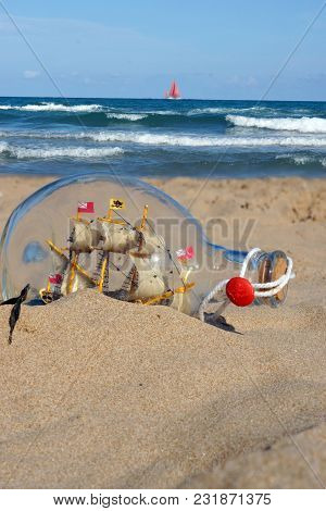 A Ship In A Glass Bottle On The Sand Near The Sea
