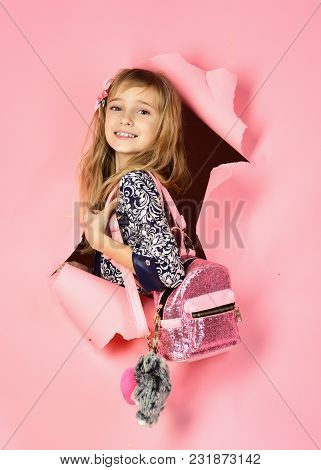 Beauty, Kid Fashion, Cosmetics, Healthy Hair. Stylish Girl With Pretty Face On Grey Background. Hair