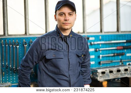 Portrait of a mechanic in front of his tools