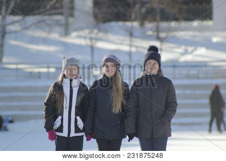Portrait Of Three Teenage Girls Wearing Winter Hats In Winter Outside, Youth Pastime And Rest
