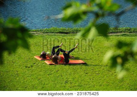 Wellness, Bodycare, Health, Healthcare. Women Athletes Do Yoga Exercises, Training. Sport, Yoga, Pil