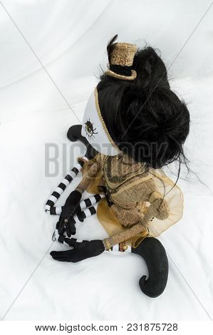 Creepy Steampunk Rag Doll Posed In A Sitting, Kneeling Position Looking Left, High Angle View. Lifes