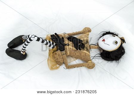 Creepy Steampunk Rag Doll Lying On Back With Raised Knees. High Angle View. Lifesize Doll On A Grung