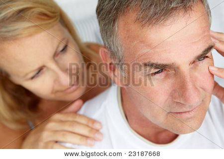 Woman comforting anxious husband