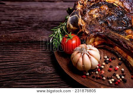 Close Up Delicious Grilled Beefsteak With Peppercorn, Garlic, Tomato And Pepper On Dark Wooden Backg