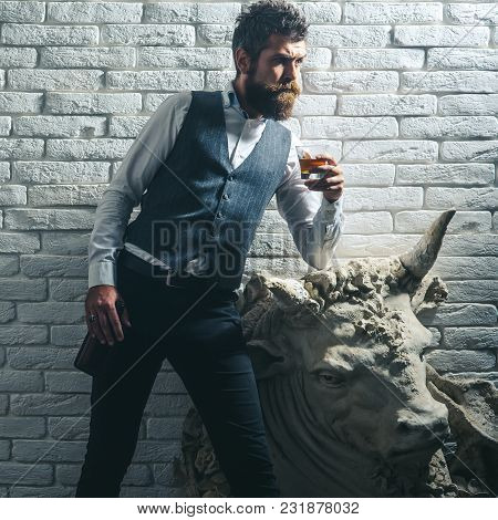 Man Critic At Historical Statue, Heritage, Property. Sculpture, Business, Architecture. Bearded Man