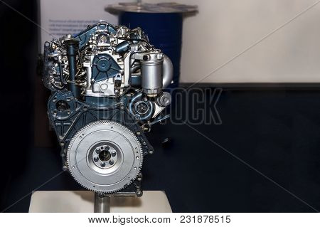 Photo Of A Turbo-diesel Engine, At An Exhibition, Close-up