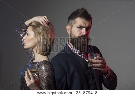 Couple Stand Back To Back With Wineglasses. Couple Quarreled At Corporate Party. Desperate Woman In