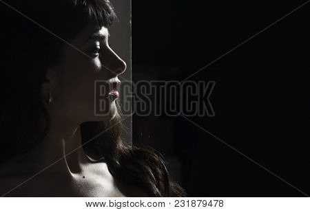 Girl With Rays Of Light And Shadows On Her Body. Erotic And Attraction Concept. Woman With Mysteriou