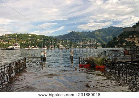 Empty Pier In A Mountain Lake Como, Italy