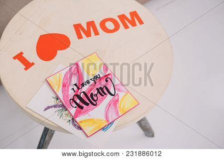 High Angle View Of Mothers Day Greeting Cards Lying On Table