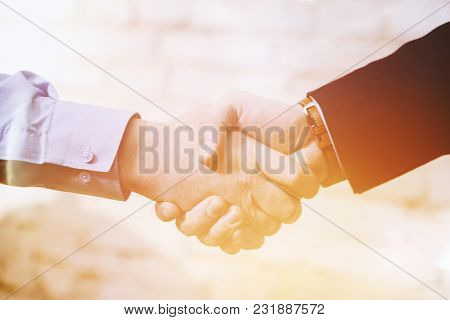Hand Shaking.two Business Man Giving A Shakehand. Business Deal.