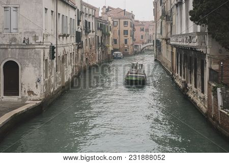 boat in water channel by daytime in Venice poster
