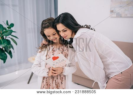 Daughter Showing Greeting Card To Mother, Mothers Day Concept