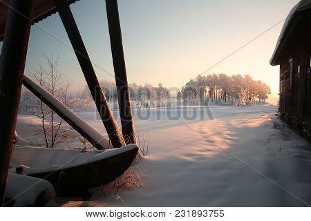 Winter Sunset At Lake Menstraesket In Vaesterbotten, Sweden
