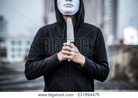 Mystery Man In White Mask Putting Knife On His Throat Considering Suicide. Depression Self Destructi
