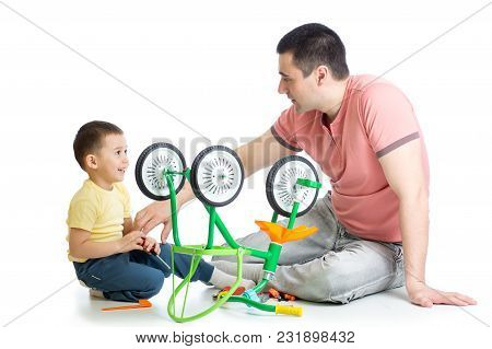 Daddy Fixing Children Bicycle With His Kid Son, Isolated