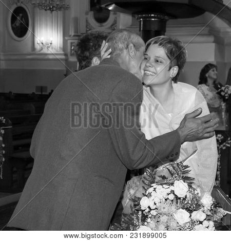 Lutsk, Volyn / Ukraine - July 26 2009: Bride On His Wedding Day Hugging Relatives At Church