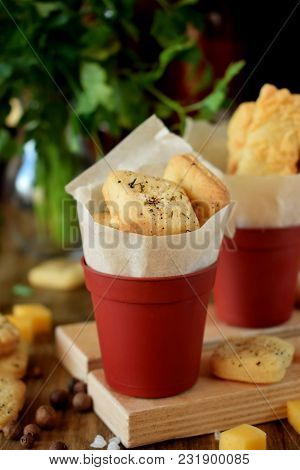 Crackers With Salt And Spices In Tiny Portion Buckets