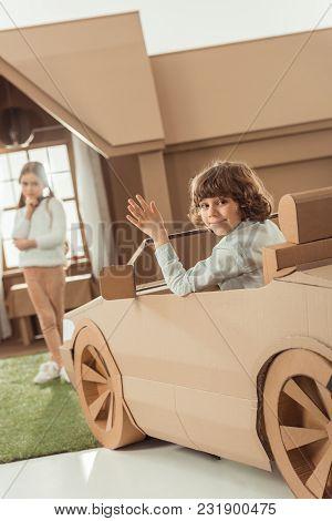 Happy Little Kid Arrived For Girlfriend On Cardboard Car