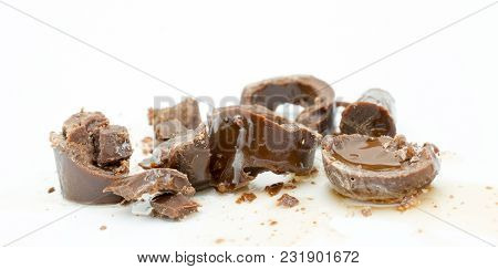 Candy With Sweet Cherry,chocolate And Syrup Liquors On A White Background.