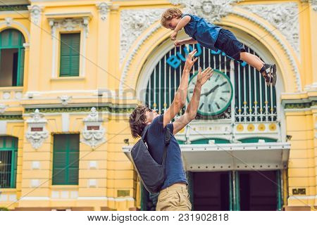 Father And Son On Background Saigon Central Post Office On Blue Sky Background In Ho Chi Minh, Vietn
