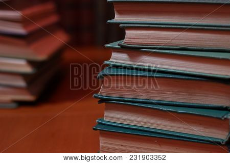 Stacks Of Colored Books On A Wooden Table. Concept Of Reading Habits