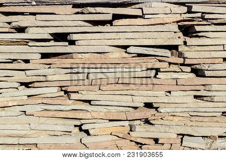 Fragment Of A Wall Made Of Stone. Stone Wall.fragment Of A Wall Made Of Stone. Stone Wall.