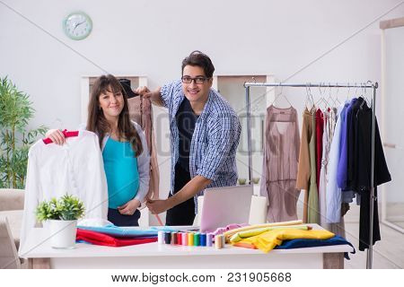Pregnant woman visiting tailor for new clothing
