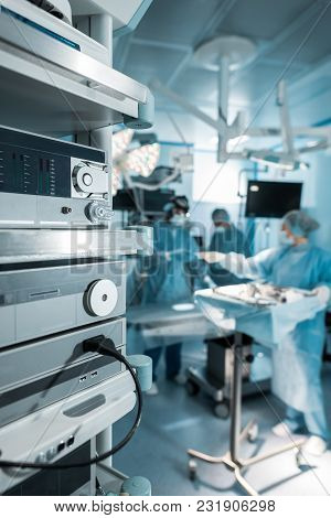 Four Surgeons In Operating Room In Hospital